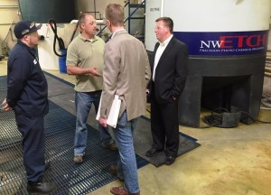 Ryan Mulligan, Ray Swift & Glenn Dooley present Congressman Derek Kilmer with recent updates and efficiency improvements in NW Etch's water treatment process.